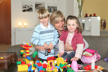 happy grandmother playing legos with grandchildren