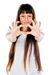 Small and beautiful girl shows fingers heart