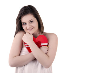 Beautiful girl with a heart shape in her hands isolated on white
