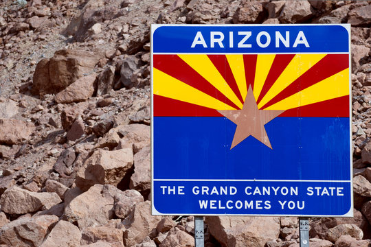 Welcome to Arizona sign with rocks background