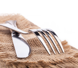 Cutlery served in rustic style isolated on a white background
