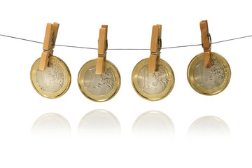 One Euro coins hanging on clotheshorse