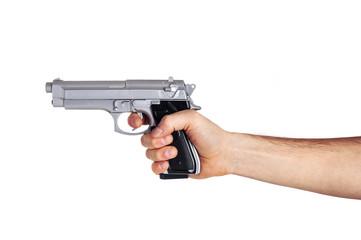 White hand holds gun isolated on white background.