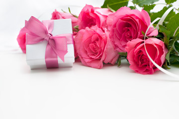 Bouquet of roses and gift box