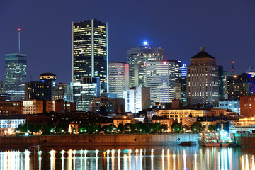 Wall Mural - Montreal over river at dusk