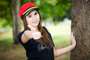 Portrait of young beautiful asian girl showing thumbs up