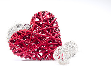 Large red wicker heart and three white balls