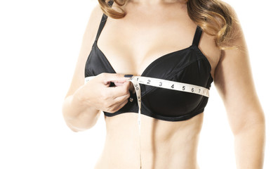 woman measuring her bust size isolated on white