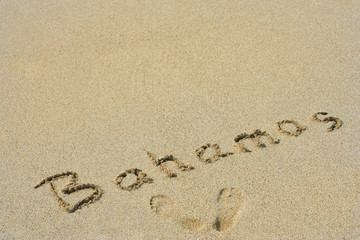 Conceptual handwritten text Bahamas in sand