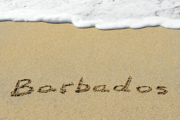 Conceptual handwritten text Barbados in sand