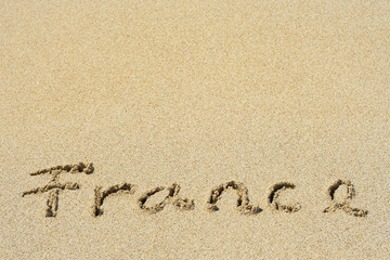 Conceptual handwritten text France in sand