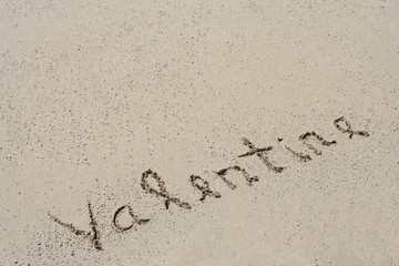 Conceptual handwritten text Valentine in sand