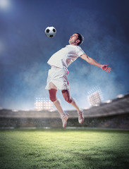 Poster Soccer ball football player striking the ball