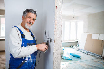 Senior man working on the electrical installations