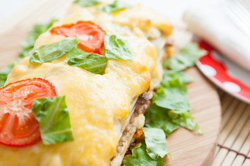 Vegetable lasagna with tomato on top