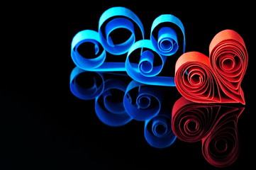 Red and blue ribbon hearts on black background