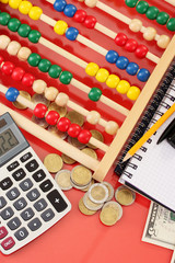 Bright wooden abacus and calculator. Conceptual photo of old