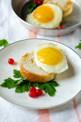 Crostini with a fried egg . Breakfast.