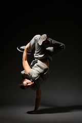 hip-hop dancer standing on one hand