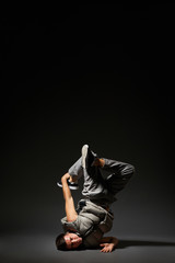 hip-hop dancer posing over dark