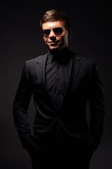 stylish smiley man in black formal wear