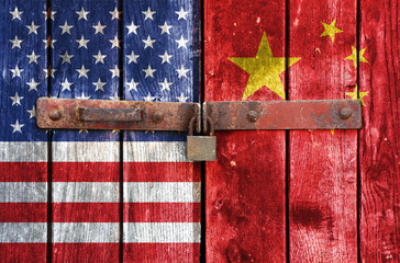 American and China flag on the background of old locked doors