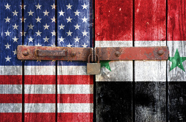 American and Syria flag on the background of old locked doors
