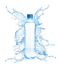 Fresh water splashing out of bottle