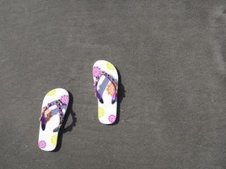 Flip-flops on the black sand of Tenerife island, Canaries