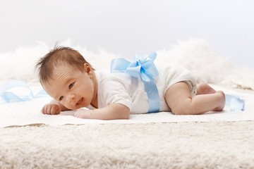 Newborn baby lying on front