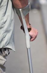 Male holding a crutch