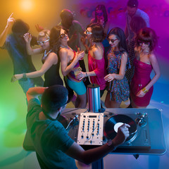 young people dancing at party with dj
