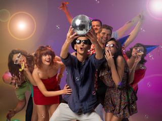 young people amazed by a disco ball