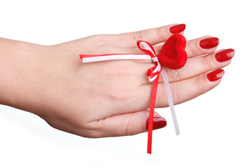 red manicure and red heart