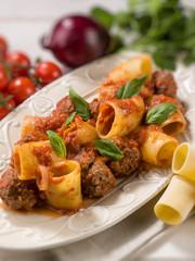 paccheri pasta with meatballs, selective focus