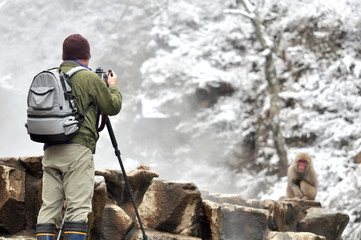 A man taking photos in Snow Monkey, Japan