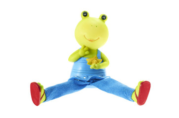 Figurine of a frog on a white background.