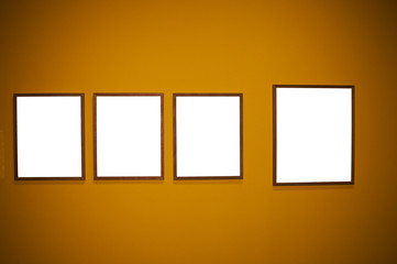 Four frames on brown wall
