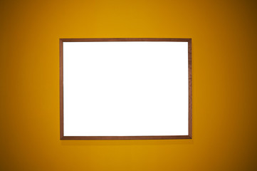 Frame on brown wall