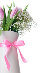 pink tulips in a white jug with ribbon