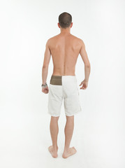 Rear view of man in swimming trunks