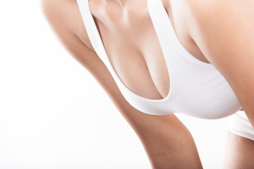 Woman breast in bodice