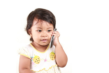 cute little girl talking to cell phone