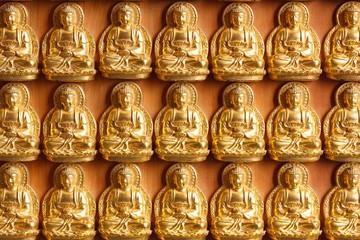 golden buddhas wall