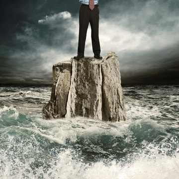 Standing on the rock in the sea