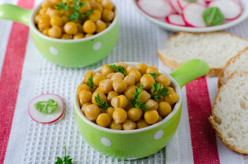 Boiled chickpeas in a green bowl