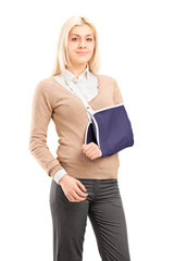 Young woman with a broken arm wearing arm brace
