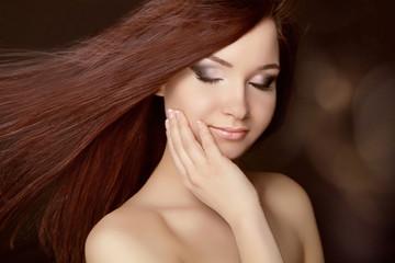Beautiful woman with long brown hair. Closeup portrait of fashio