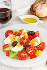 salad with boiled egg on the plate