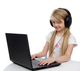 girl in headphones with a laptop.